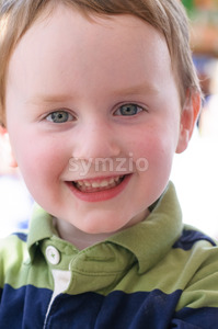 Young boy riding on fairground horse on carousel amusement ride at fairgrounds park outdoor Stock Photo