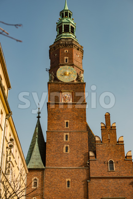 Wroclaw, Poland - March 4, 2018: Wroclaw Town Hall clock tower in evening in historic capital of Silesia, Poland, Europe. Stock Photo