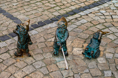 Wroclaw, Poland - March 4, 2018: Wroclaw, a miniature statue of a gnome on the main square of the city. Stock Photo