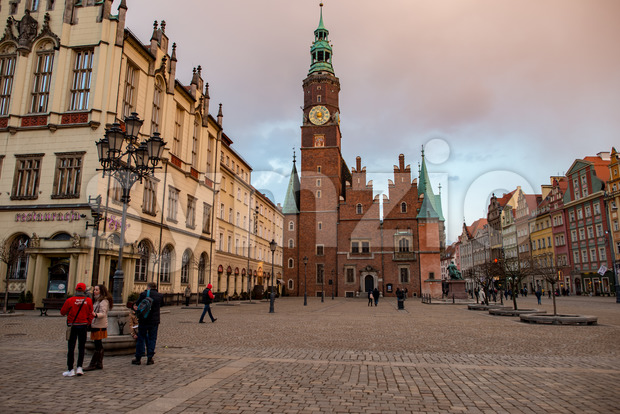 Wroclaw, Poland - March 8, 2018: Wroclaw Town Hall clock tower in evening in historic capital of Silesia, Poland, Europe. Stock Photo