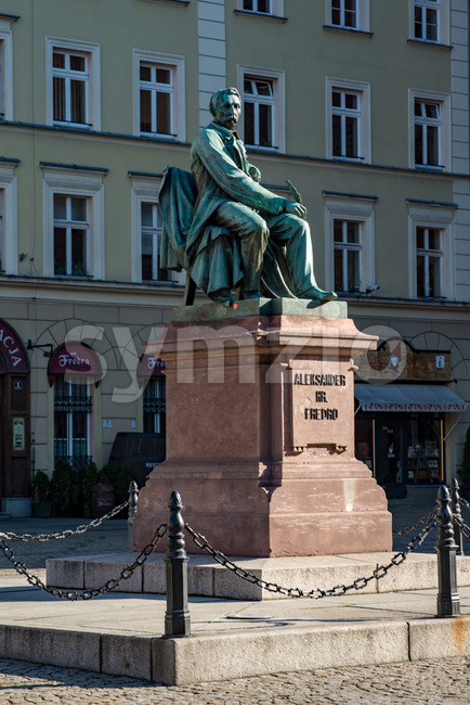 Wroclaw, Poland - March 9, 2018: Neoclassical bronze statue of famous Polish writer Alexander Fredro, 1897, by Leonard Marconi in warm sunlight , Stock Photo
