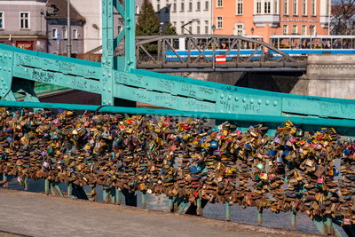 Wroclaw, Poland - March 9, 2108: Symbolic love padlocks fixed to the railings of grunwaldzki bridge, Wroclaw, Poland. Stock Photo