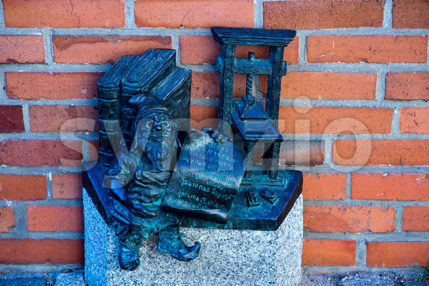 Wroclaw, Poland - March 9, 2018: Wroclaw, a miniature statue of a gnome on the main square of the city. Stock Photo