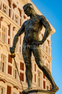 Wroclaw, Poland, March 9, 2018: Naked swordsman in the square in front of the University of Wroclaw Stock Photo