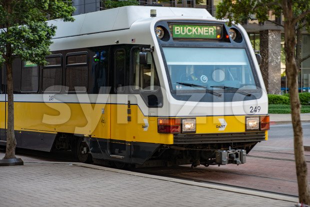 Dallas, Texas - May 7, 2018: The Dallas DART light rail train drives through Dallas, Texas Stock Photo
