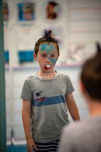 Boy with face painted like a shark Stock Photo