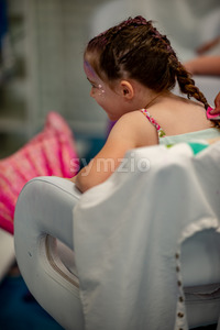 Portrait of a beautiful young mermaid girl at salon getting makeup on Stock Photo