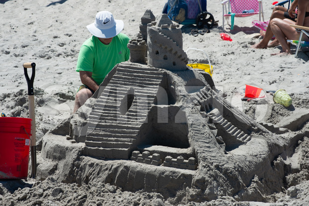 Ocean City, NJ - June 8, 2018: View of a lavish and large sand castle being built on the beach