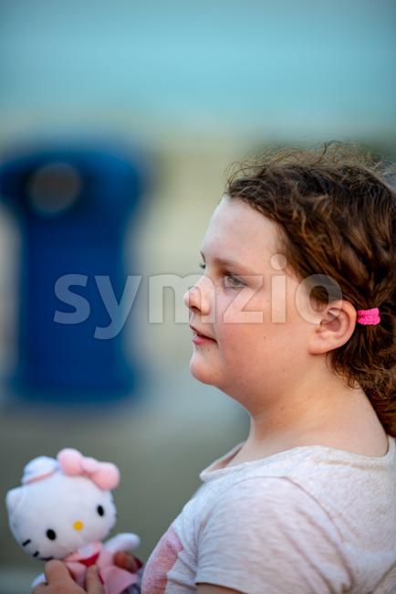 Happy young girl having fun on boardwalk amusement ride Stock Photo