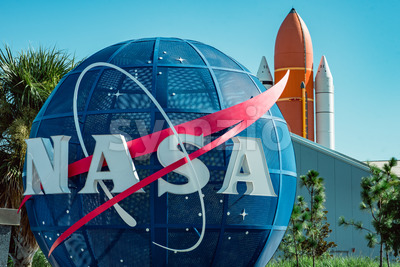 Cape Canaveral, Florida - August 13, 2018: NASA globe with space shuttle booster rocket in backgrond at NASA Kennedy Space Center Stock Photo
