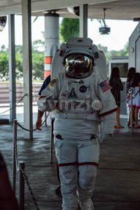 Cape Canaveral, Florida - August 13, 2018: Person in Astronaut space cuit walking by and waving at NASA Kennedy Space Center Stock Photo