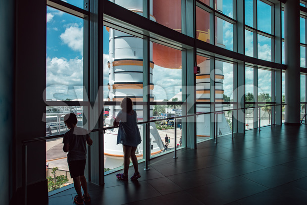 Cape Canaveral, Florida - August 13, 2018: View of kids looking out at Atlantis Space Shuttle Rocket Booster at NASA ...