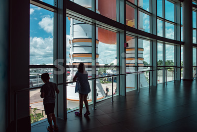 Cape Canaveral, Florida - August 13, 2018: Kids looking out at Atlantis Space Shuttle Rocket Booster at NASA Kennedy Space Center Stock Photo