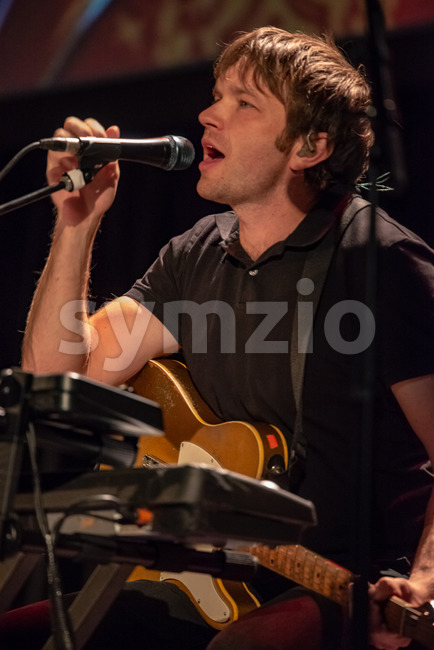 ITHACA, NY - NOVEMBER 4, 2018: Vocalist Andy Ross of the band OK Go performs on their Live Videos tour at the State Theatre of Ithaca Stock Photo