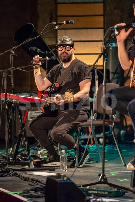 ITHACA, NY - NOVEMBER 4, 2018: Bass guitarist Tim Nordwind of the band OK Go performs on their Live Videos ...