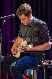 ITHACA, NY - NOVEMBER 4, 2018: Lead vocalist Guitarist Damian Kulash of the band OK Go performs on their Live Videos tour at the State Theatre of Stock Photo