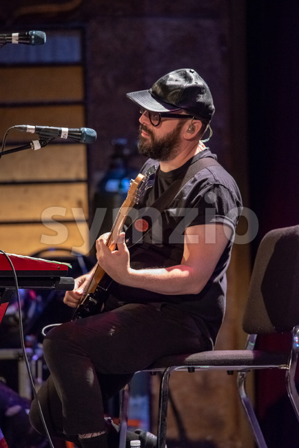 ITHACA, NY - NOVEMBER 4, 2018: Bass guitarist Tim Nordwind of the band OK Go performs on their Live Videos tour at the State Theatre of Ithaca Stock Photo