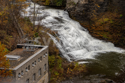 Pedestrian Suspension Bridge over Triphammer Falls, Ithaca, New York. Waterfall in the middle of Cornell University campus Stock Photo