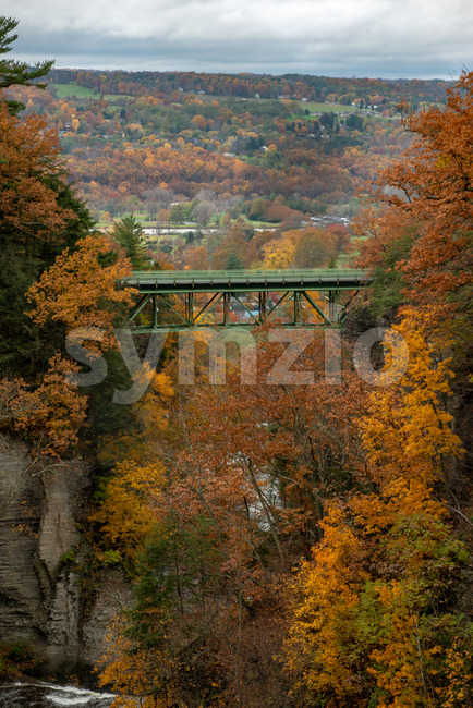 Pedestrian Suspension Bridge over Triphammer Falls, Ithaca, New York. Waterfall in the middle of Cornell University campus
